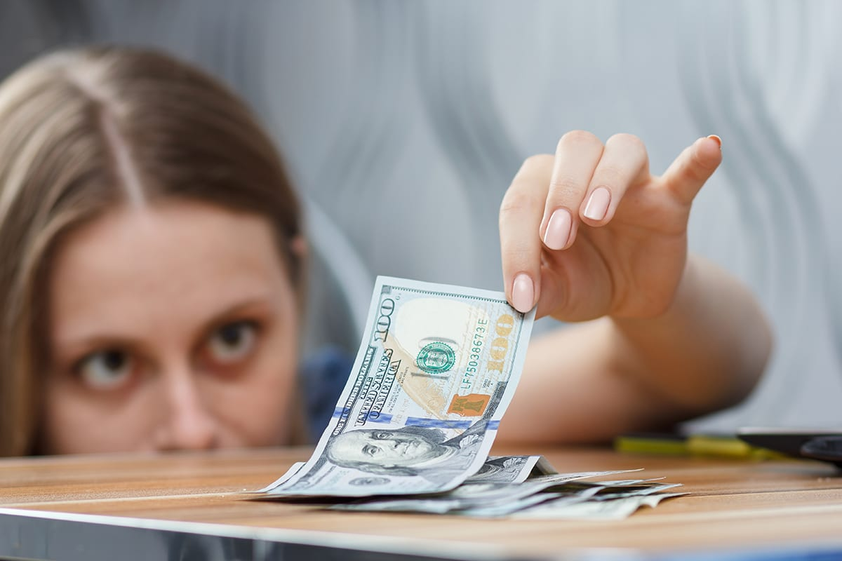 Woman Gently Picking Up Money