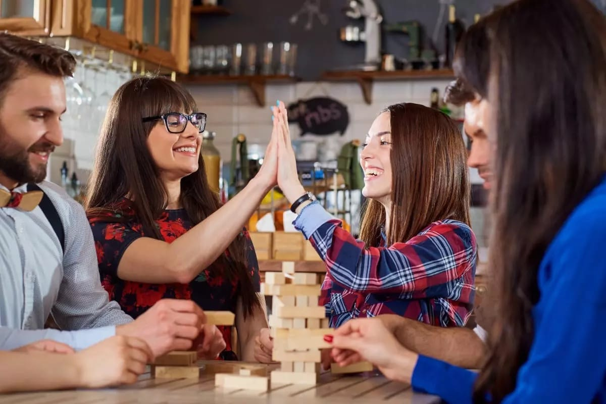 Group of People Playing Jenga