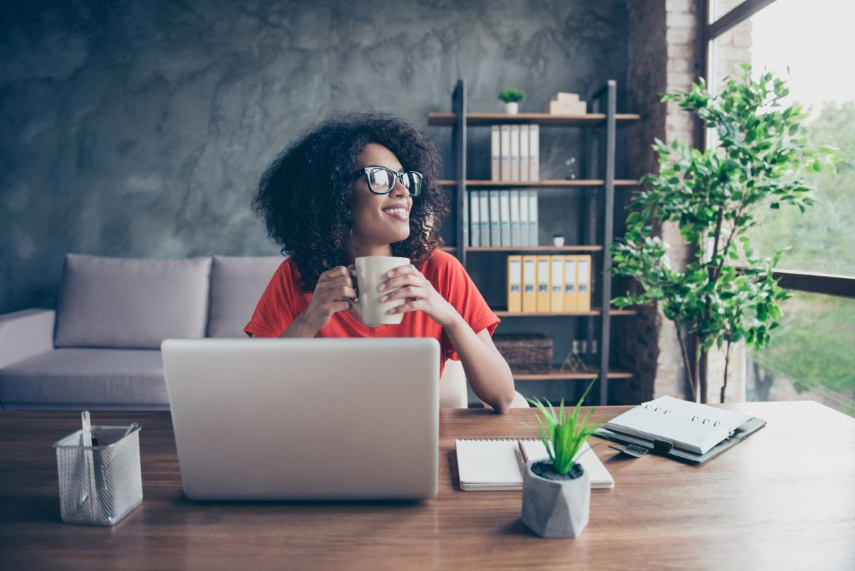 Woman Feeling Happy at Her Desk